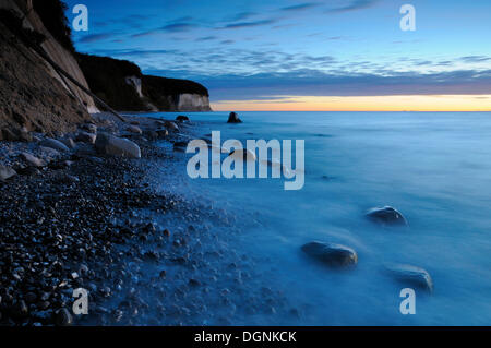 Sunrise at the chalk cliffs near Sassnitz, Jasmund National Park, Ruegen, Mecklenburg-Western Pomerania - Stock Photo