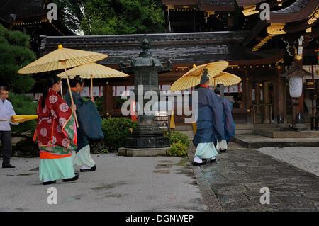 Traditional oil-paper umbrellas used during the rain in Imamiya Shrine, Jidai-Matsuri Autumn Festival, Kyoto, Japan, - Stock Photo
