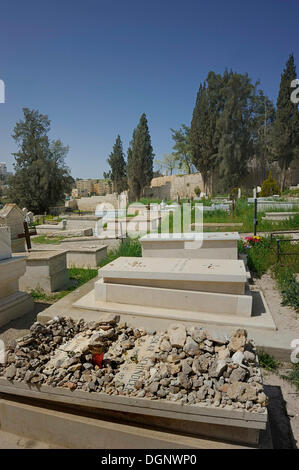 Grave of Oskar Schindler, many grave stones according to the Jewish cemetery tradition, Franciscan cemetery on Mount - Stock Photo