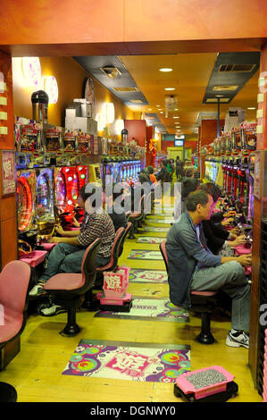 Pachinko, gambling devices, giant amusement arcade with slot machines, the most popular gambling game in Japan, - Stock Photo