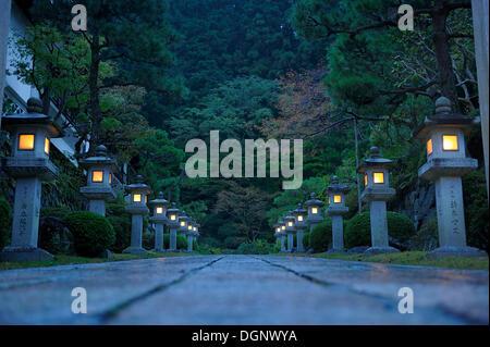Path to a monastery in the evening lit by stone lanterns, Koya-san, Wakayama, near Osaka, Japan, East Asia - Stock Photo