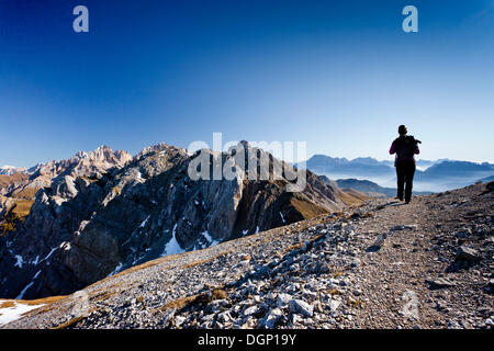 Hiker during the ascent to the Bepi-Zac fixed rope route in the San Pellegrino Valley above the San Pellegrino Pass, - Stock Photo