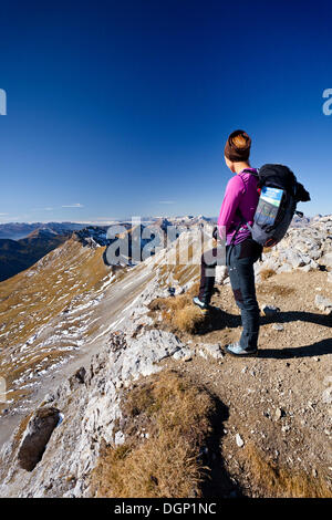 Female hiker on Cima Campagnacia Mountain near the Bepi-Zac climbing route in the San Pellegrino Valley - Stock Photo