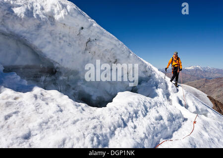 Mountain climber descending from Monte Cevedale, here at the margin, Alto Adige, Italy, Europe - Stock Photo