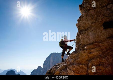 Mountain climber climbing the Marino Bianchi climbing route on Monte Cristallo to the summit of Cristallo di Mezzo, - Stock Photo