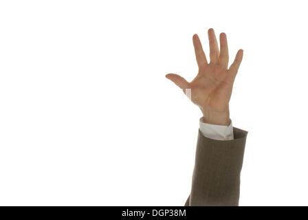 The hand of a man in a suit reaching from below into the frame - Stock Photo