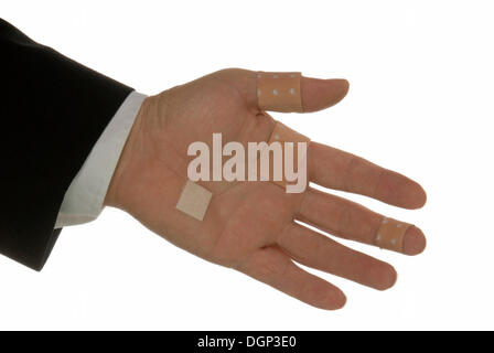 Business man with injury offering a hand shake, symbolic image for business despite the ailing economy, financial - Stock Photo