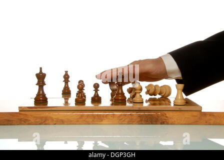 Businessman throwing chess figures around after losing game - Stock Photo