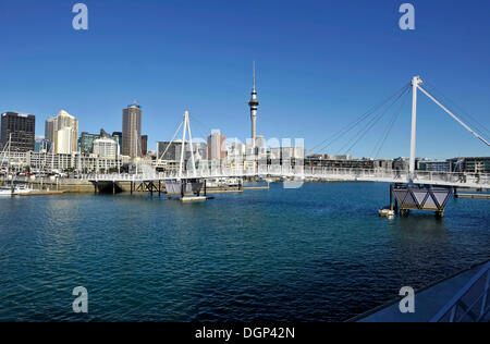 View of the new bascule bridge from the Viaduct Events Centre, behind the sykline, Auckland, New Zealand - Stock Photo