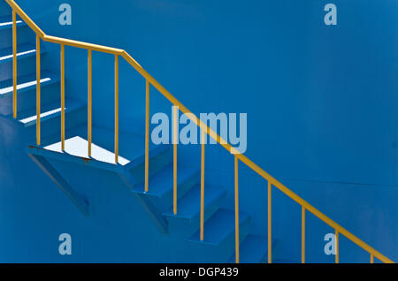 Yellow banister rails on a blue silo - Stock Photo