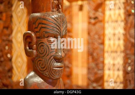 Traditional Maori carving at a communal house, Waitangi, New Zealand - Stock Photo
