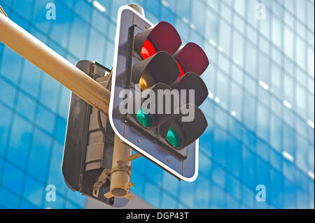 Traffic lights in front of a modern façade, Auckland, Auckland Region, New Zealand - Stock Photo