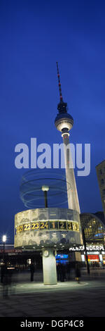 World clock and the television tower on Alexanderplatz Square, Berlin - Stock Photo