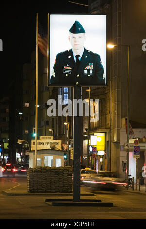 Portrait of an American soldier at the former border crossing of Checkpoint Charlie, Berlin - Stock Photo
