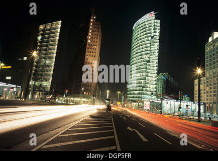 Rush Hour on Potsdamer Platz with DB Tower and Kollhoff Tower, Berlin - Stock Photo