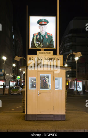 Portrait of a Russian soldier at the former border crossing Checkpoint Charlie, Berlin - Stock Photo