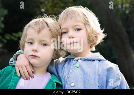 Two sisters, three and five years - Stock Photo