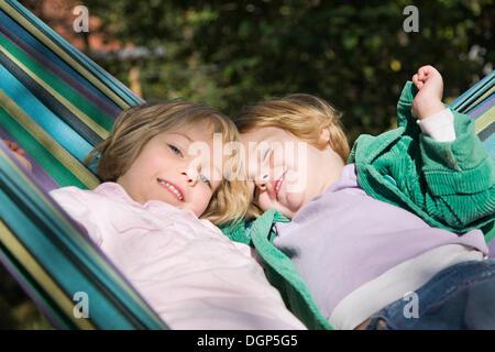 Two girls in a hammock - Stock Photo