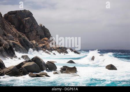 Waves breaking on the rocky coast near Valle di Luna, Sardinia, Italy, Europe - Stock Photo