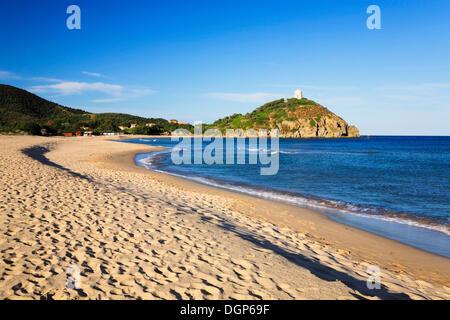 Spiaggia di Colonia beach overlooking the Torre di Chia, Saracen Tower in the evening light, Sulcis Province, Sardinia, - Stock Photo