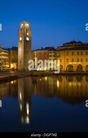 The old town of Riva del Garda reflected in the port basin, Lake Garda, Trentino, Alto Adige, Italy, Europe - Stock Photo