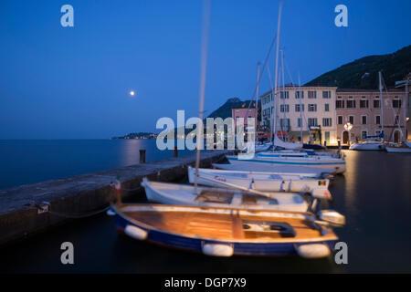 Moon over the port of Gargnano, Lake Garda, Lombardy, Italy, Europe - Stock Photo