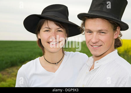 Young couple with hats - Stock Photo
