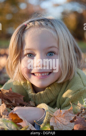 Six-year-old girl in autumn, portrait - Stock Photo