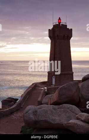 Phare de Ploumanac'h or Phare de Mean Ruz lighthouse on the Côte de Granit Rose or Pink Granite Coast, Ploumanac'h, - Stock Photo