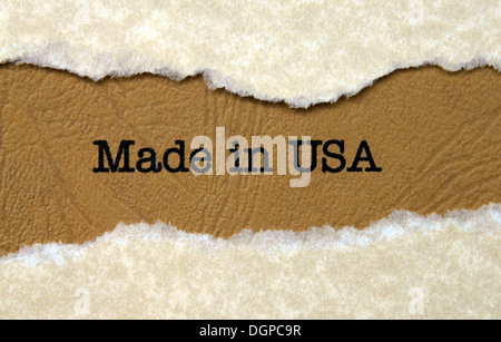 Made in USA text on paper hole - Stock Photo