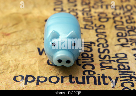 Opportunity text on grunge paper with piggy bank - Stock Photo