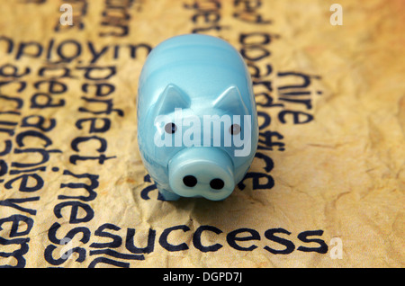 Success text on grunge paper with piggy bank - Stock Photo