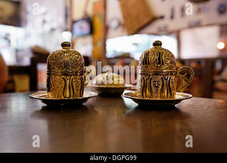 Mocha, Turkish coffee in traditional golden cups, Old City Sultanahmet, Istanbul, Turkey, Europe - Stock Photo