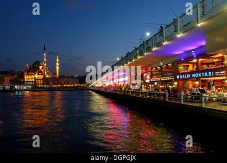 New Mosque, Yeni Cami in the Eminoenue district, Galata bridge, Golden Horn, Istanbul, european side, Turkey, Europe - Stock Photo