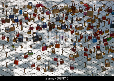 Love locks on Makartsteg bridge over the Salzach River, Salzburg, Salzburg State, Austria - Stock Photo