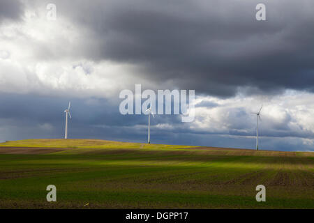 Wind turbines in Havelland between Ketzin and Nauen after a rainstorm, Brandenburg - Stock Photo