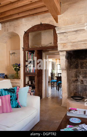 Large Open Stone Fireplace In Vaulted Dining Room With