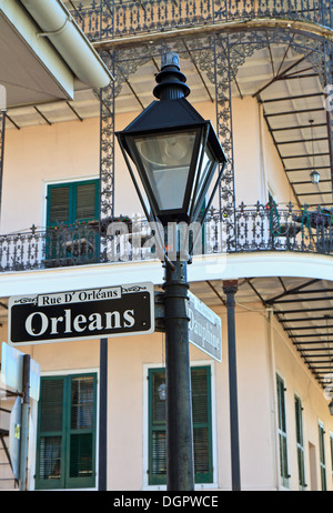 A lamp post and wrought iron balconies at the corner of Orleans and Dauphine streets in the French Quarter of New - Stock Photo