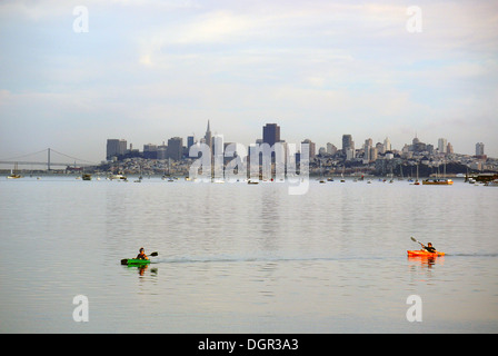 two kayakers paddle on San Francisco Bay in Marin County - Stock Photo