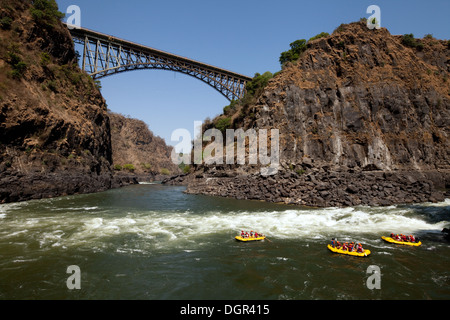 Adventure holiday, people white water rafting on the Zambezi River at the Victoria Falls Bridge, Zambia, Africa - Stock Photo