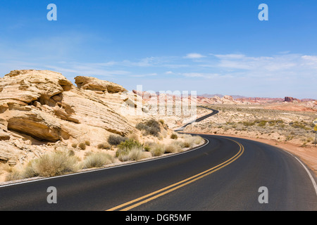 Empty road through Valley of Fire State Park in the White Domes area, north of Las Vegas, Nevada, USA - Stock Photo
