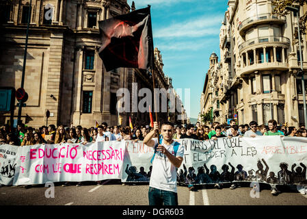 Barcelona, Spain. October 24th, 2013: Tens of thousands of protestors gather behind their banner during a demonstration - Stock Photo