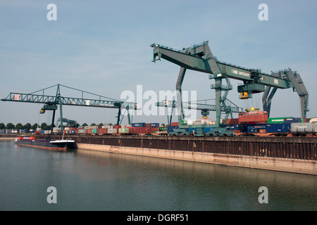 Container terminal beside in river Rhine, Germany. - Stock Photo