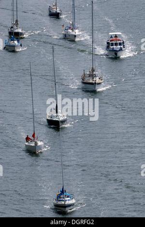 Sailing boats, pleasure craft traffic on Kiel Canal, Schleswig-Holstein - Stock Photo