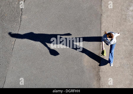 Shadow of a walker from a bird's eye view - Stock Photo