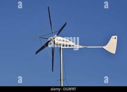 Small wind turbine, wind generator - Stock Photo