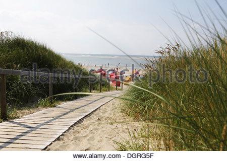 Germany, Lower Saxony, East Frisia, Langeoog, way to the beach - Stock Photo
