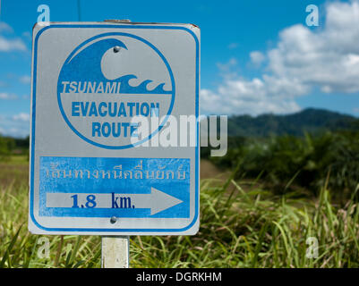Tsunami warning sign on the beach with direction to escape route, Khao Lak, Phuket, Thailand, Asia - Stock Photo