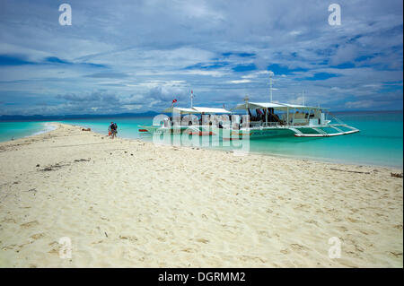 Banka, traditional Philippine outrigger boat, off the beach, Malapascua, Philippines, Asia - Stock Photo