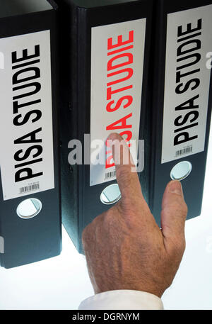 Hand pointing to a file folder labeled 'PISA', German for 'Programme for International Student Assessment, PISA' - Stock Photo